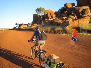 Morning departure. Gaye leaving Devils Marbles camp area. NT. Australia