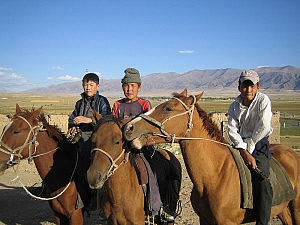 Kids hanging out on horses, Kysyl-Emgek, Uzbekistan