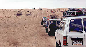 The convoy grinds to a halt with a vehicle stuck on the dune. With the large amount of sand this year the support vehicles had just as much fun as the riders negotiating the sand dunes.