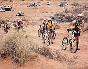 Day 2. Traditionally the hardest day of the ride with lots of sand and dunes. 100 metres from the start and we're already walking in the loose sand. Only 80k to lunch.... groan Ed at right, Gaye 4th back. Only 2 of the 40 riders avoided the sweep on this day. Jack Oldfield (the eventual winner) and Ed.