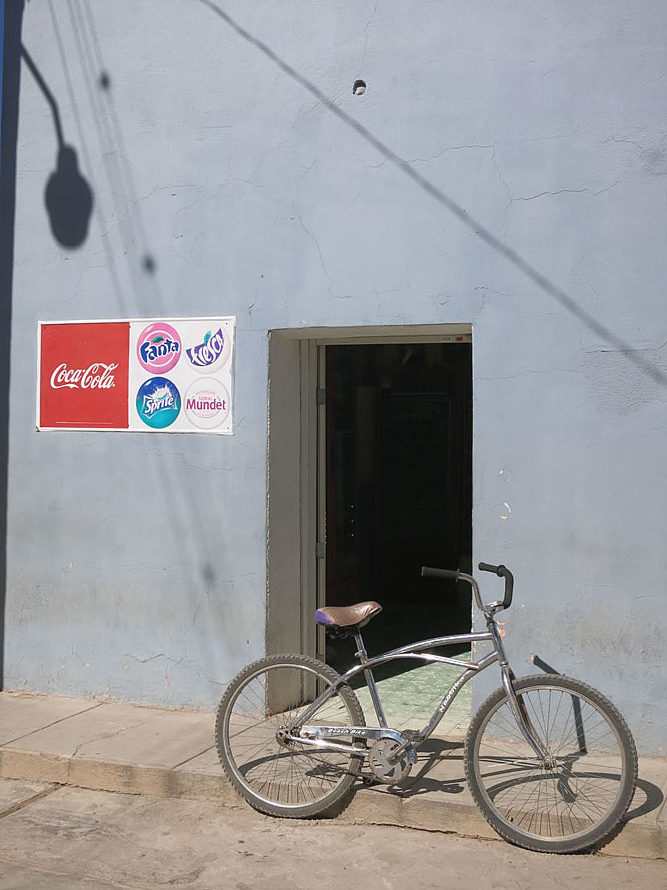 A small coke sign is often the only indication that a building is actually a shop