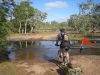 Ed crossing the Hann River. Nice fresh cooling water to drink and flop into. A good spot for camping too although we went on to Saltwater Creek.