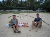 Celebrating Ed\'s birthday on the Seisia beach in front of our campground. No expense was spared as we wined and dined in great style.