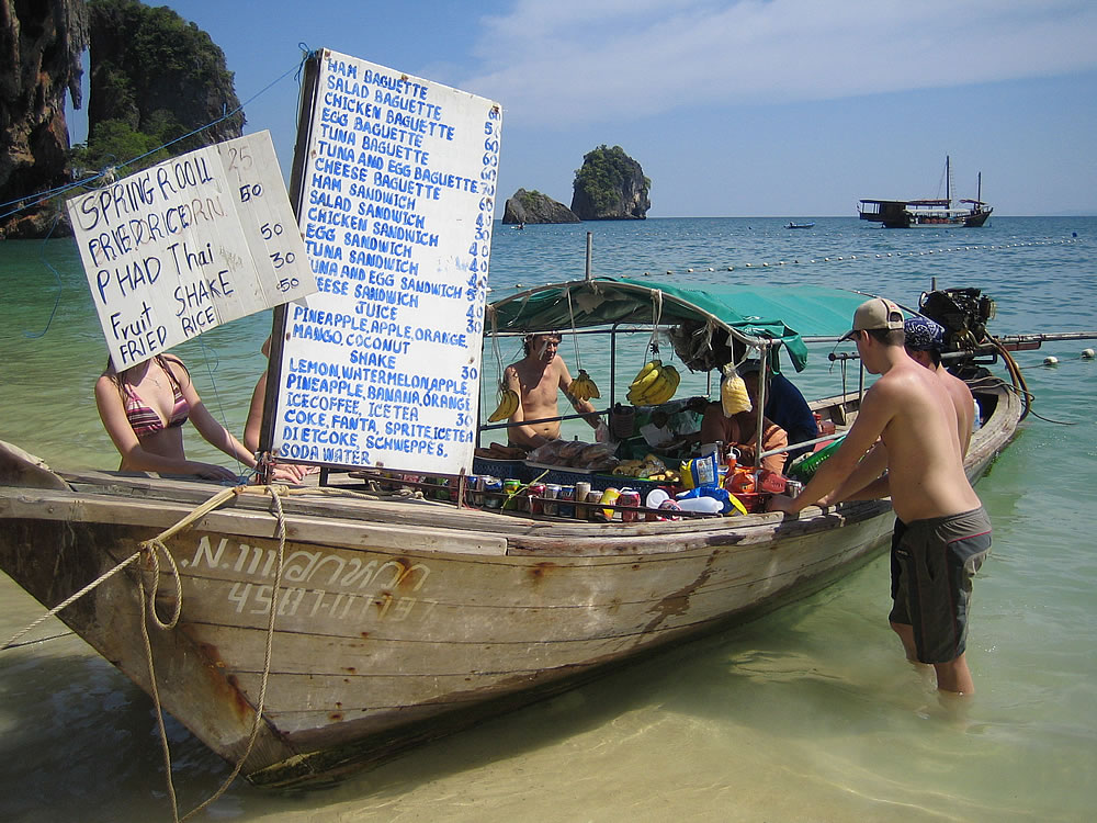 Floating shop at a popular island beach