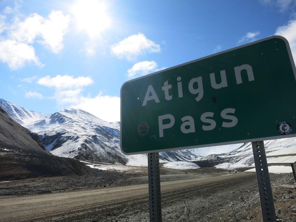 over the snowy slopes of Atigun Pass,